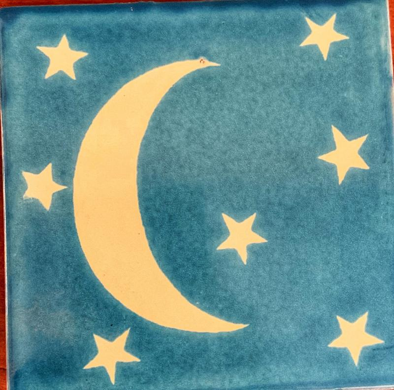 moon and stars talavera tile with light blue background