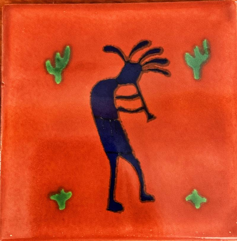 kokopelli with red background talavera tile